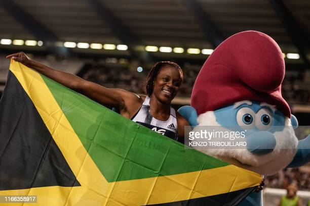 Jamaica's Danielle Williams celebrates after winning in the Women's 100m hurdles race during the IAAF Diamond League competition on September 6, 2019...