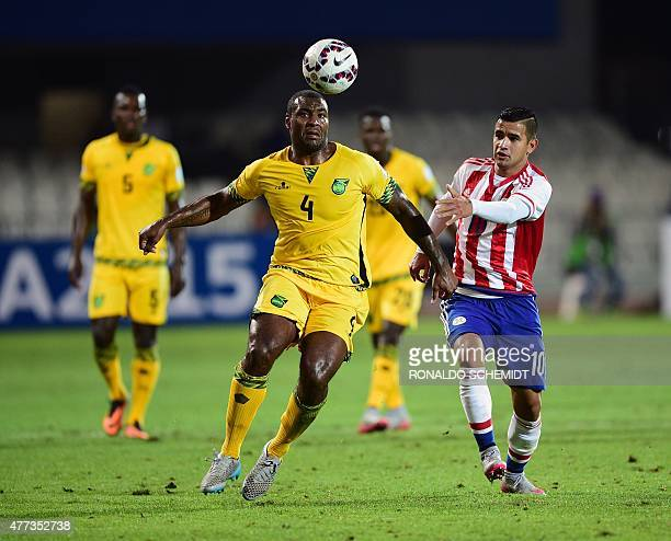 Jamaica's defender Wesley Morgan and Paraguay's forward Derlis Gonzalez vie during their 2015 Copa America football championship match in Antofagasta...