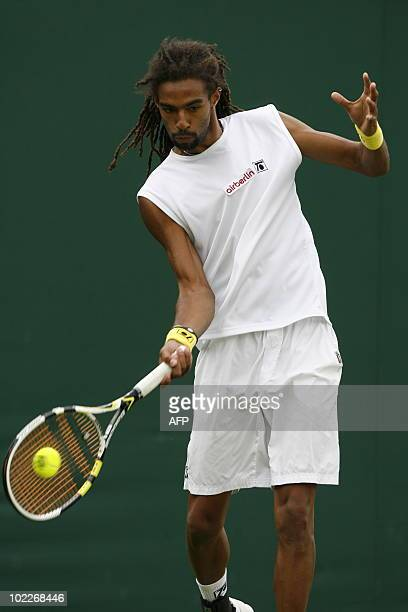 Jamaica's Dustin Brown returns a ball to Austrian player Jurgen Melzer during the Wimbledon Tennis Championships at the All England Tennis Club in...