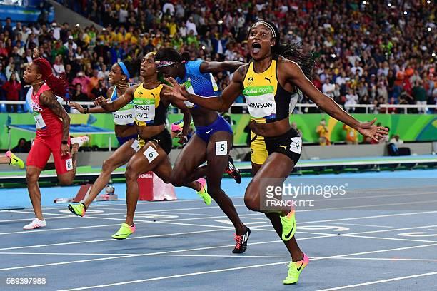 Jamaica's Elaine Thompson celebrates winning the Women's 100m Final ahead of USA's Tori Bowie, Jamaica's Shelly-Ann Fraser-Pryce, USA's English...