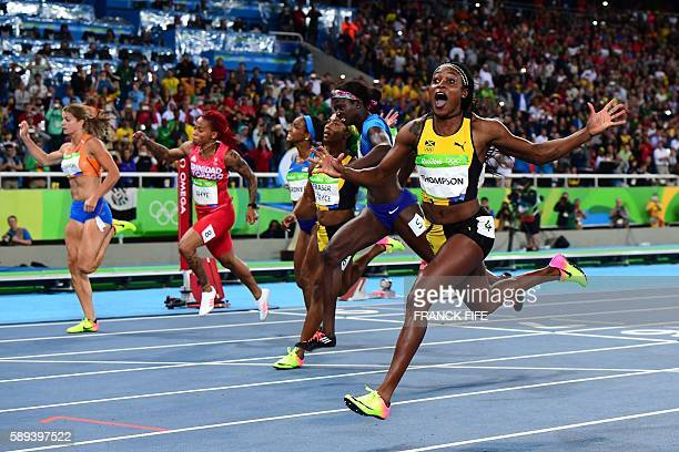 Jamaica's Elaine Thompson celebrates winning the Women's 100m Final during the athletics event at the Rio 2016 Olympic Games at the Olympic Stadium...