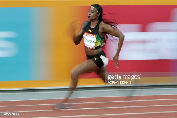 Jamaica's Elaine Thompson competes in the athletics women's 200m semi-final during the 2018 Gold Coast Commonwealth Games at the Carrara Stadium on...