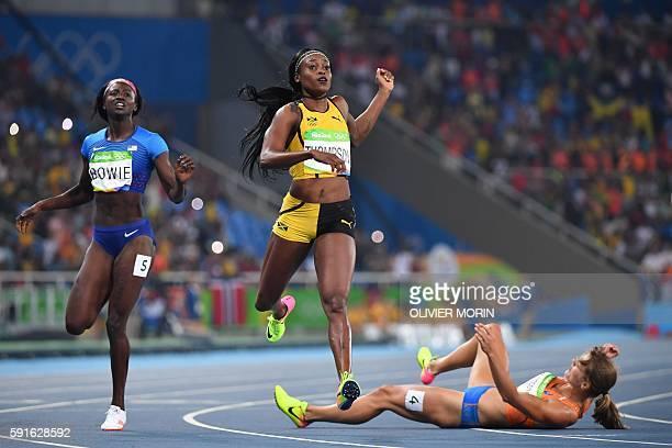 TOPSHOT Jamaica's Elaine Thompson crosses the finish line ahead of silver medallist Netherlands' Dafne Schippers and bronze medallist USA's Tori...