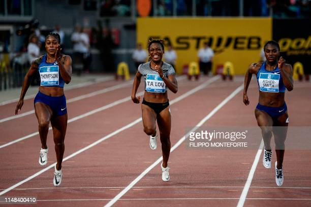 Jamaica's Elaine Thompson runs on her way to win the Women's 100m ahead of Britain's Dina AsherSmith and Ivory Coast MarieJosee Ta Lou during the...