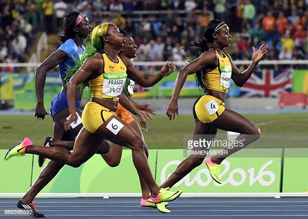Jamaica's Elaine Thompson runs to win the Women's 100m Final during the athletics event at the Rio 2016 Olympic Games at the Olympic Stadium in Rio...