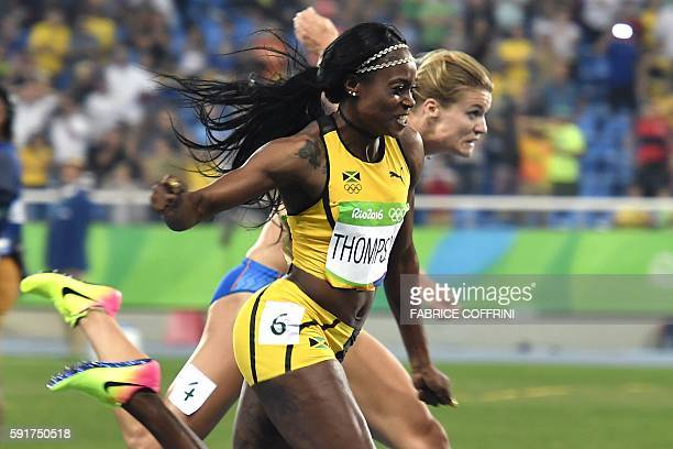 Jamaica's Elaine Thompson wins ahead of Netherland's Dafne Schippers in the Women's 200m Final during the athletics event at the Rio 2016 Olympic...