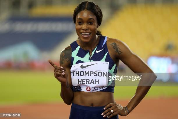 Jamaica's Elaine Thompson-Herah celebrates after winning the Women's 100m during the IAAF Diamond League competition on September 25, 2020 at the...