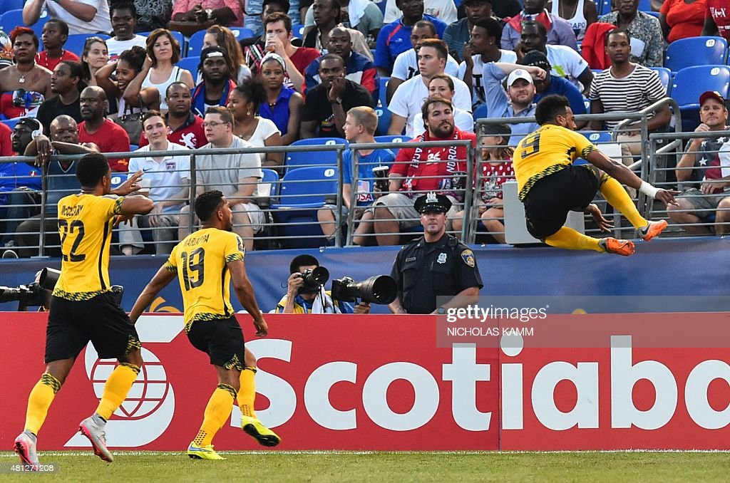 Jamaica's Giles Barnes (R) celebrates scoring against Haiti during a CONCACAF Gold Cup quarterfinal football match in Baltimore on July 18, 2015.