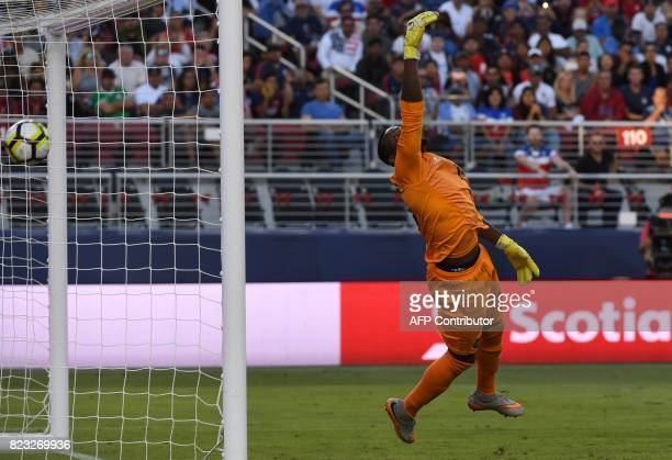 Jamaica's goalkeeper Dwayne Miller looks on a goal is scored during the final football game of the 2017 CONCACAF Gold Cup match against the USA at...