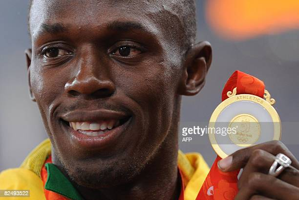 Jamaica's gold medalist Usain Bolt poses on the podium a day after the men's 200m final at the National stadium as part of the 2008 Beijing Olympic...