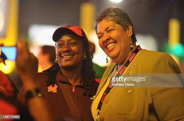 Jamaica's High Commissioner Her Excellency Aloun Ndombet Assamba poses with a guest during Jamaica A Nation on a Mission Welcomes Olympic Fans to...