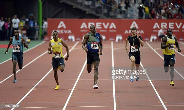 Jamaica's Jason Young, Jamaica's Warren Weir, Jamaica's Usain Bolt, France's Christophe Lemaitre and Jamaica's Nickel Ashmeade compete during the...