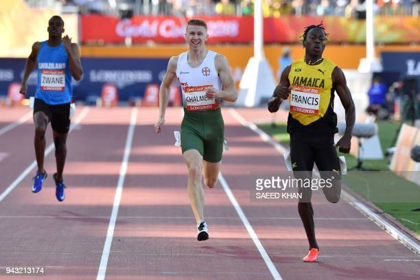 Jamaicas Javon Francis and Guernseys Cameron Chalmers compete in the athletic's men's 400m heats during the 2018 Gold Coast Commonwealth Games at the...