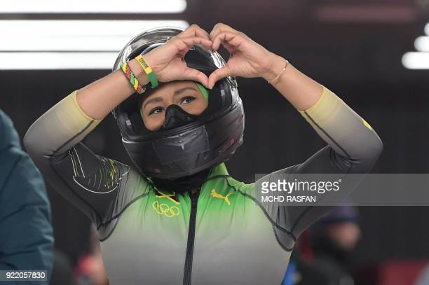 TOPSHOT Jamaica's Jazmine FenlatorVictorian and Jamaica's Carrie Russell compete in the women's bobsleigh heat 4 final run during the Pyeongchang...