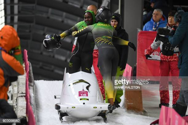 Jamaica's Jazmine Fenlator-Victorian and Jamaica's Carrie Russell compete in the women's bobsleigh heat 4 final run during the Pyeongchang 2018...
