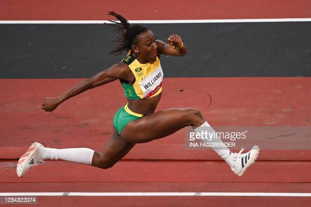 Jamaica's Kimberly Williams competes in the women's triple jump qualification during the Tokyo 2020 Olympic Games at the Olympic Stadium in Tokyo on...