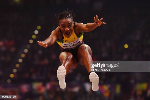 Jamaica's Kimberly Williams competes in the women's triple jump final at the 2018 IAAF World Indoor Athletics Championships at the Arena in...
