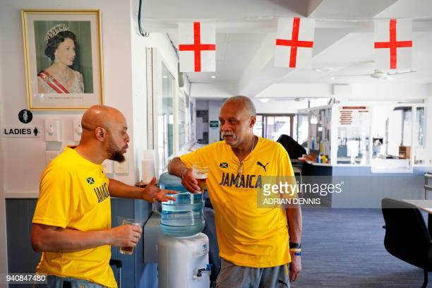 Jamaica's lawn bowls players Andrew Newell and Melvyn Edwards talk tactics while drinking a beer in the clubhouse following a practice session at...