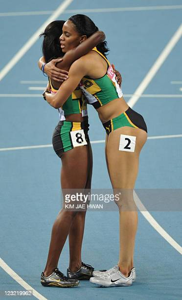 Jamaica's Melaine Walker celebrates with Jamaica's Kaliese Spencer after the women's 400 metres hurdles final at the International Association of...