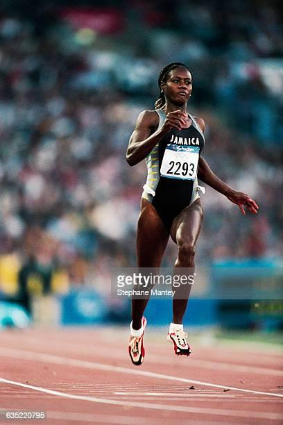 Jamaica's Merlene Ottey runs in her 100-meter heat at the Sydney Olympic Games.