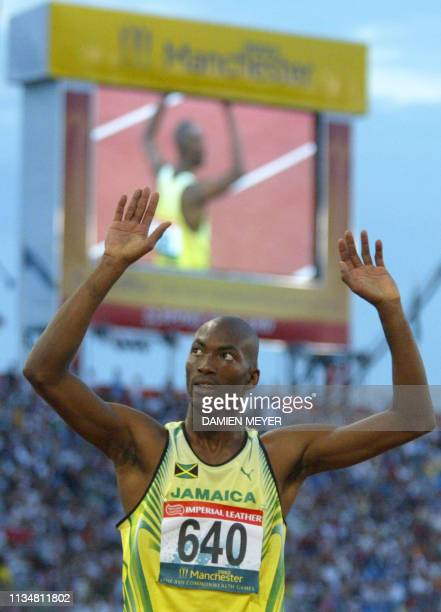 Jamaica's Michael Blackwood celebrates his gold medal after the 2002 Manchester Commonwealth Games men's 400m 28 July 2002. AFP PHOTO ADRIAN DENNIS