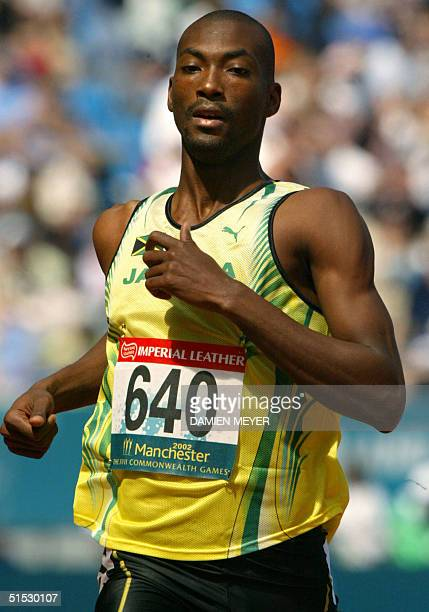 Jamaica's Michael Blackwood in action during the 2002 Manchester Commonwealth Games 400m first round 26 July 2002. AFP PHOTO DAMIEN MEYER