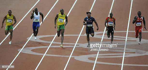 Jamaica's Michael Frater Britain's Tyrone Edgar Jamaica's Usain Bolt Walter Dix of the US St Kitts and Nevis' Kim Collins and Trinidad and Tobago's...