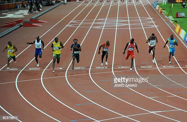 Jamaica's Michael Frater Britain's Tyrone Edgar Jamaica's Usain Bolt Walter Dix of the US St Kitts and Nevis' Kim Collins Trinidad and Tobago's Marc...