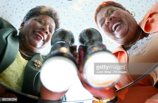 Jamaica's Minister for Tourism Aloun Ndombet Assamba enjoys her first pint of Guinness in the Guinness Gravity bar Dublin with Director General of...