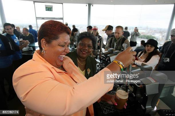 Jamaica's Minister for Tourism Aloun Ndombet Assamba enjoys pulling her first pint of Guinness in the Guinness Gravity bar Dublin with Director...
