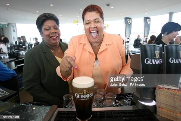 Jamaica's Minister for Tourism Aloun Ndombet Assamba enjoys pulling her first pint of Guinness in the Guinness Gravity bar Dublin with the Director...