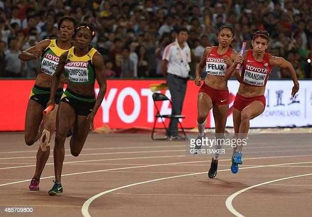 Jamaica's Natasha Morrison hands the baton to Jamaica's Elaine Thompson and USA's Allyson Felix hands off to USA's Jenna Prandini in the final of the...