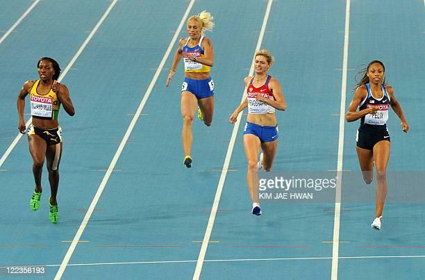 Jamaica's Novlene WilliamsMills Ukraine's Nataliya Pyhyda Russia's Antonina Krivoshapka and US athlete Allyson Felix compete in their women's 400...