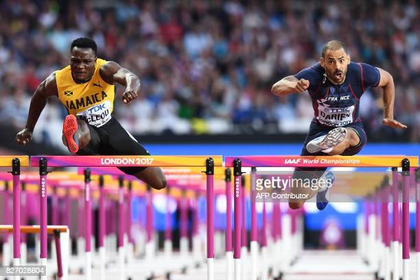 Jamaica's Omar Mcleod and France's Garfield Darien compete in the semifinals of the men's 110m hurdles athletics event at the 2017 IAAF World...