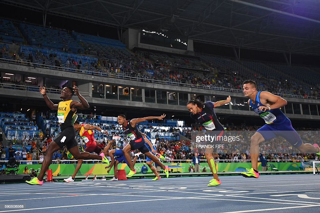 TOPSHOT - Jamaica's Omar McLeod (L) celebrates as he wins the Men's 110m Hurdles Final during the athletics event at the Rio 2016 Olympic Games at the Olympic Stadium in Rio de Janeiro on August 16, 2016. / AFP / FRANCK