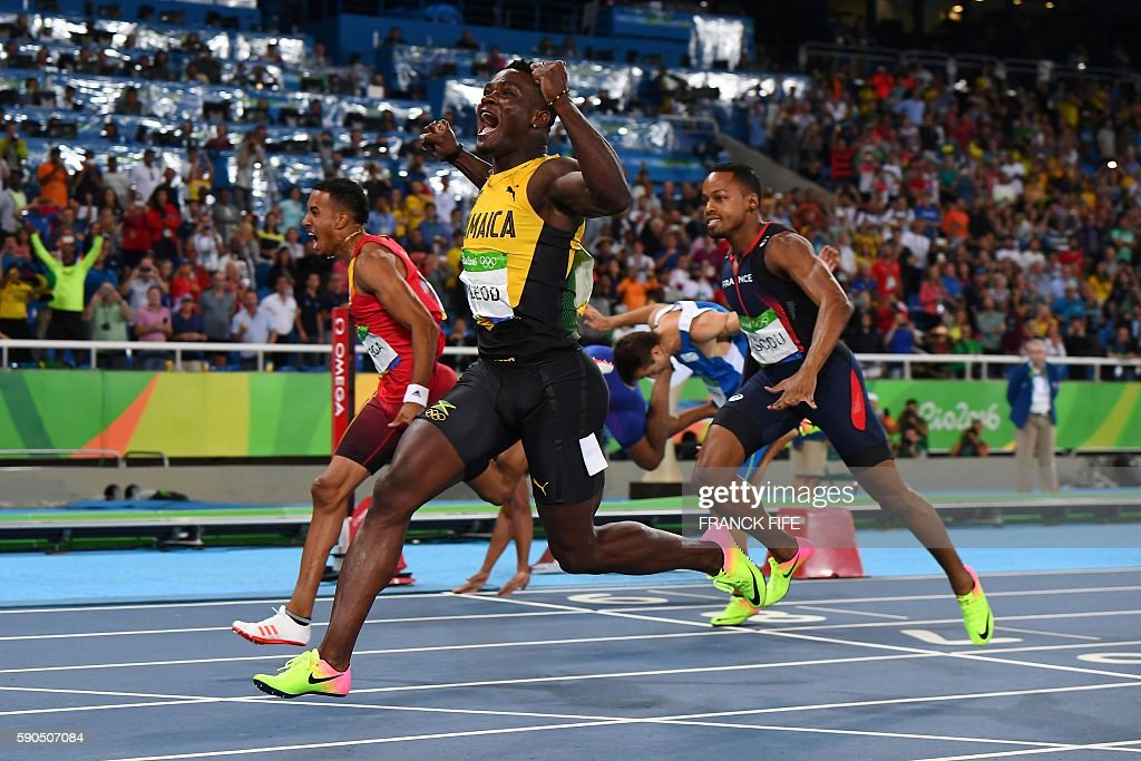 TOPSHOT - Jamaica's Omar McLeod celebrates as he wins the Men's 110m Hurdles Final during the athletics event at the Rio 2016 Olympic Games at the Olympic Stadium in Rio de Janeiro on August 16, 2016. / AFP / FRANCK