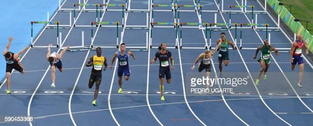 Jamaica's Omar McLeod croses the finish line agead of France's Pascal MartinotLagarde and USA's Devon Allen as they competed with Canada's Johnathan...