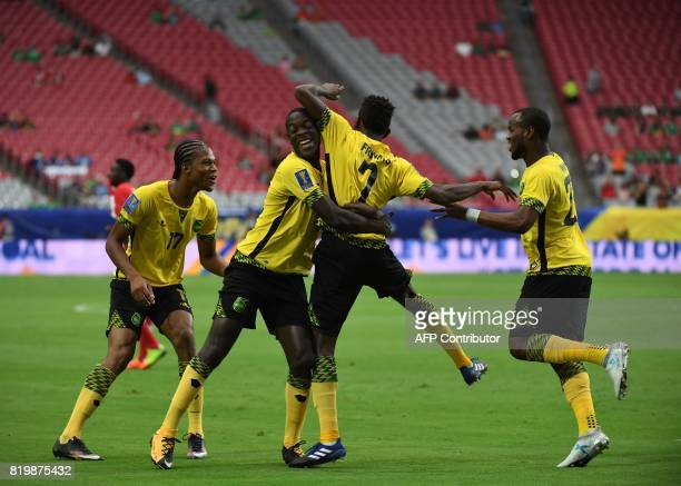 Jamaica's Shaun Francis celebrates with teammates after scoring against Canada in their quarter final game during the 2017 CONCACAF Gold Cup at the...
