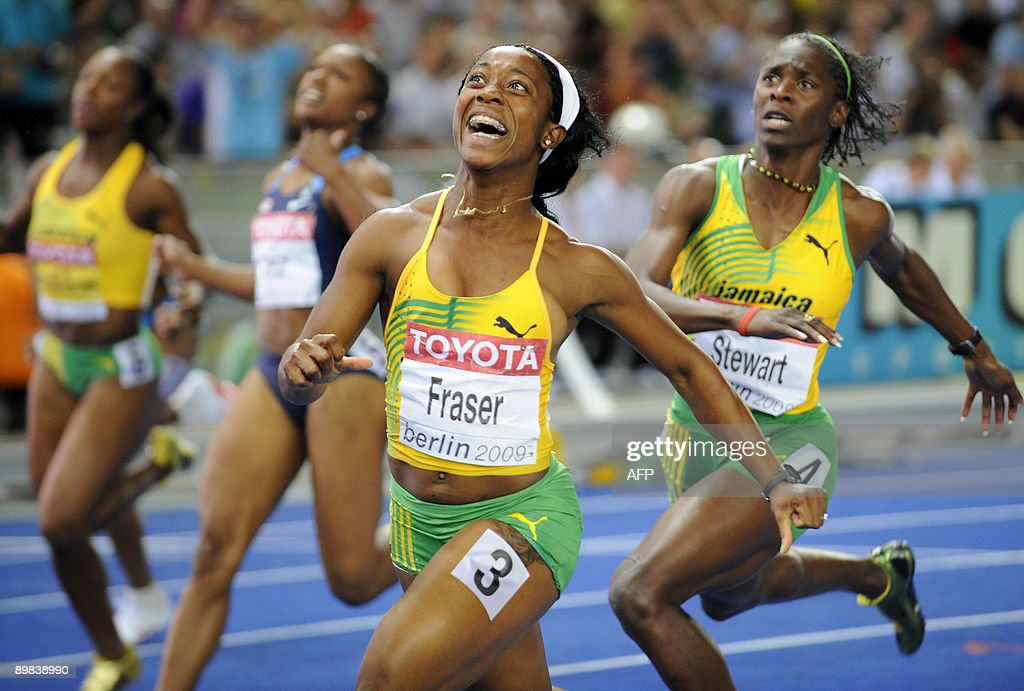 Jamaica's Shelly-Ann Fraser (C) reacts she crosses the finish line first in the women's 100m final race of the 2009 IAAF Athletics World Championships on August 17, 2009 in Berlin.
