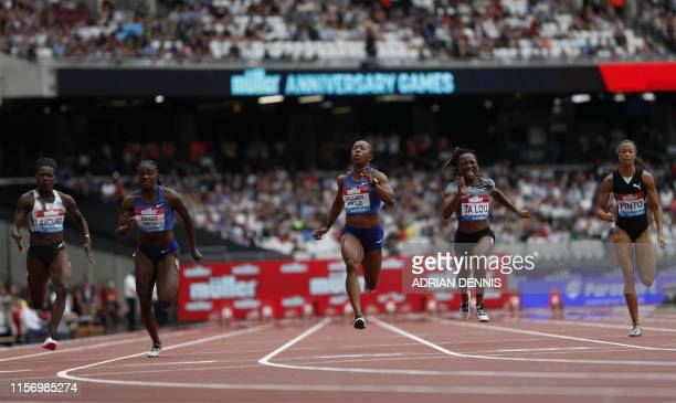 Jamaica's Shelly-Ann Fraser-Pryce crosses the line ahead of second-placed Britain's Dina Asher-Smith and third-placed Ivory Coast's Marie-Josée Ta...
