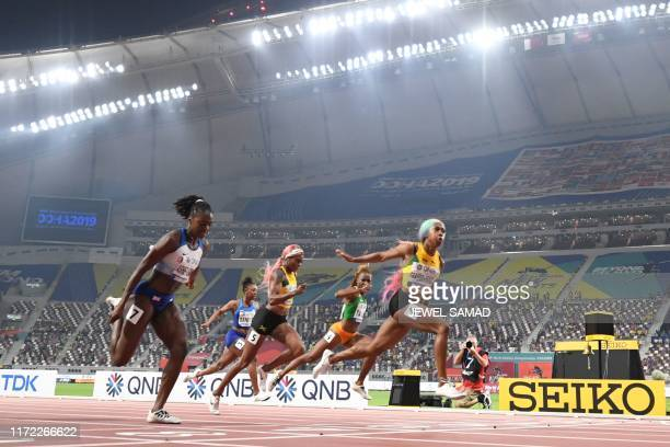 TOPSHOT Jamaica's ShellyAnn FraserPryce finishes first ahead of Britain's Dina AsherSmith Ivory Coast's MarieJosee Ta Lou and Jamaica's Elaine...