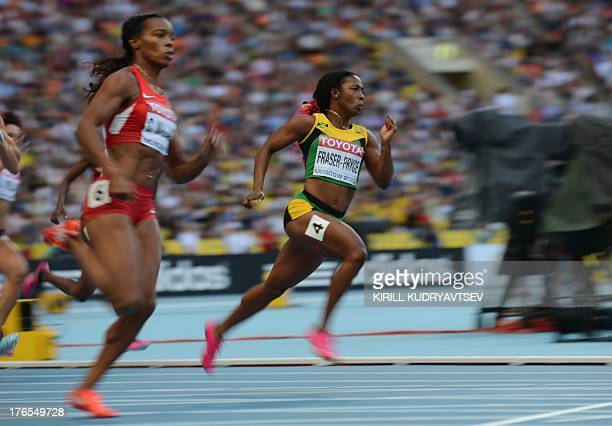 Jamaica's ShellyAnn FraserPryce leads US ChaRonda Williams during the women's 200 metres semifinal at the 2013 IAAF World Championships at the...