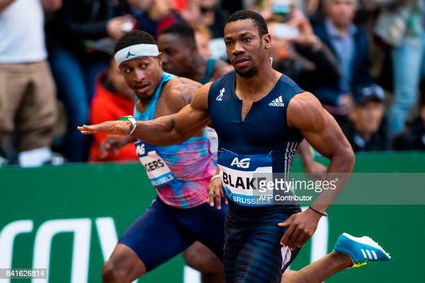 Jamaica's sprinter Yohan Blake celebrates as he crosses the finish line to win ahead of US ichael Rodgers the men's 100m race during the AG Insurance...