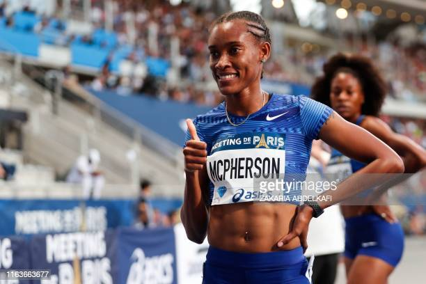 Jamaica's Stephenie Ann McPherson celebrates after winning in the Women's 400m during the IAAF Diamond League competition on August 24 2019 at the...