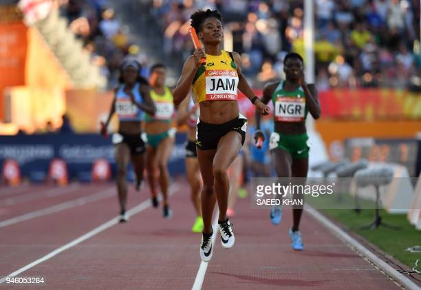 Jamaica's Stephenie McPherson crosses the line to win the athletics women's 4x400m relay final during the 2018 Gold Coast Commonwealth Games at the...