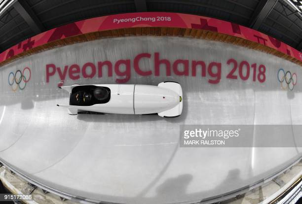 Jamaica's team leader and driver Jazmine FenlatorVictorian corners in the first men's unofficial bobsleigh training session at the Olympic Sliding...