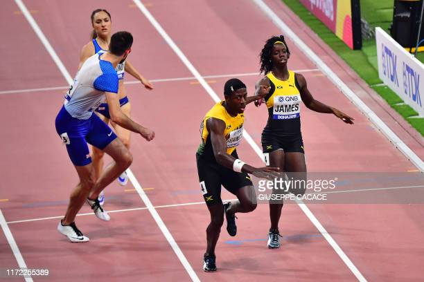 Jamaica's Tiffany James passes the baton to Jamaica's Javon Francis in the Mixed 4 x 400m Relay final at the 2019 IAAF World Athletics Championships...