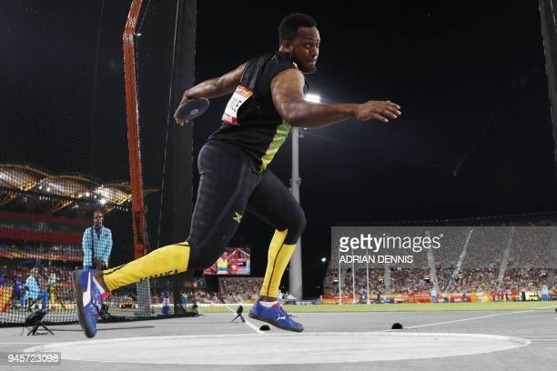 Jamaicas Traves Smikle competes in the athletics men's discus throw final during the 2018 Gold Coast Commonwealth Games at the Carrara Stadium on the...