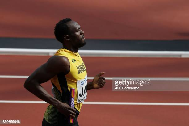TOPSHOT Jamaica's Usain Bolt anchors his team to victory in their heat of the men's 4x100m relay athletics event at the 2017 IAAF World Championships...