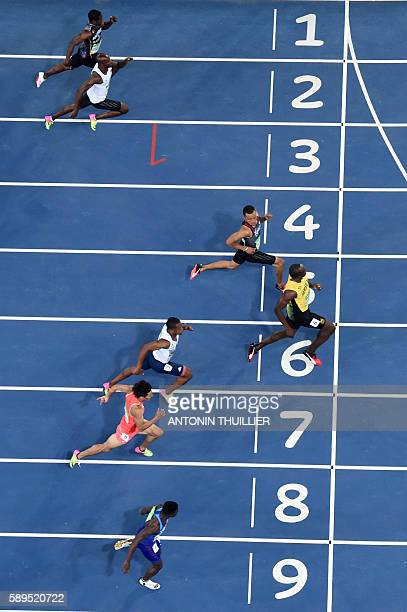 Jamaica's Usain Bolt and Canada's Andre De Grasse compete in the Men's 100m Semifinal during the athletics event at the Rio 2016 Olympic Games at the...